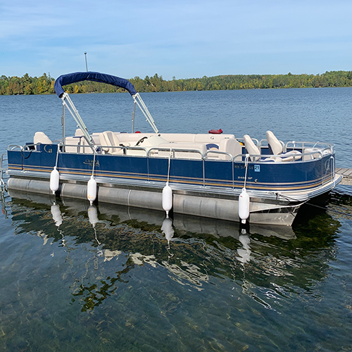 24' Pontoon docked at Cedar Point resort that is availavble for rent.