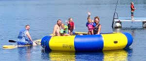 Famly on a floating raft on North Star Lake at Cedar Point Resort