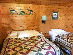 Queen and twin bed bedroom