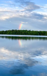 Rainbow over the shore of North Star Lake at Cedar Point Resort in Marcell, MN