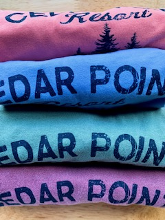 Stack of sweatshirts available for sale at Cedar Point Resort